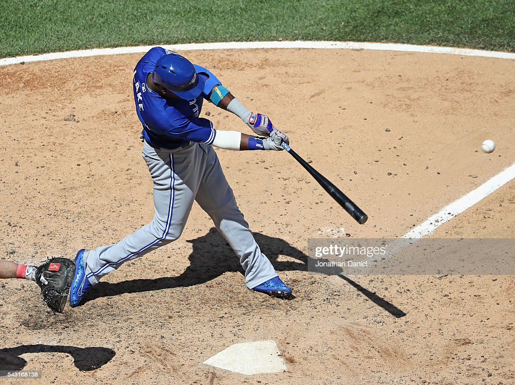 Junior Lake #48 of the Toronto Blue Jays hits a solo home run in the 8th inning against the Chicago White Sox at U.S. Cellular Field on June 26, 2016 in Chicago, Illinois. The White Sox defeated the Blue Jays 5-2.