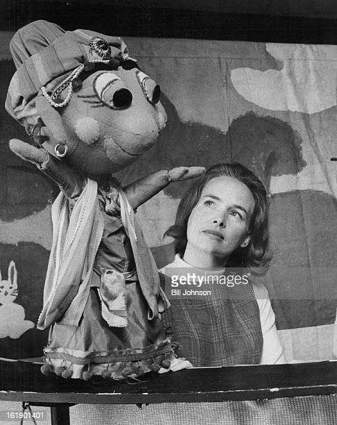 FEB 11 1969 FEB 18 1969 FEB 23 1969 Junior League puppeteer Mrs Fred Larkin keeps watchful eye on playful antics of Genie during a performance of...