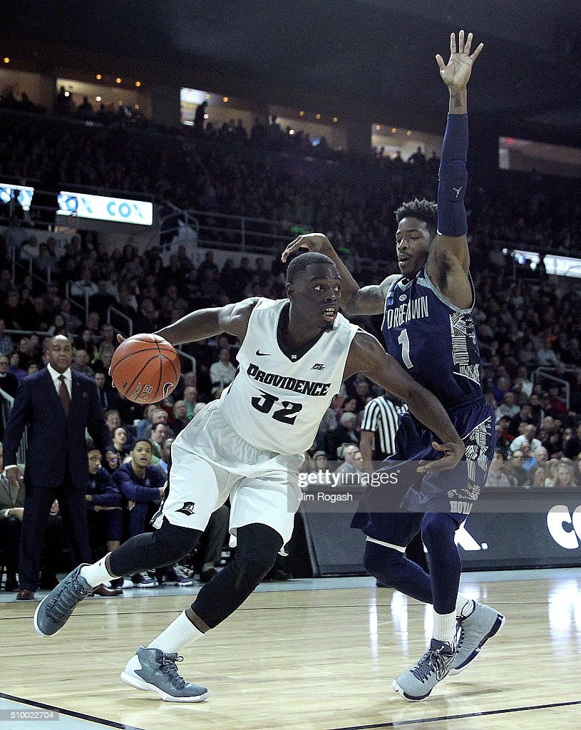 Junior Lomomba #32 of the Providence Friars drives by Tre Campbell #1 of the Georgetown Hoyas in the second half on February 13, 2016, at the Dunkin' Donuts Center in Providence, Rhode Island.