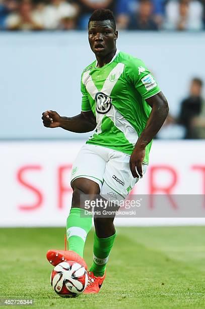 Junior Malanda of VfL Wolfsburg controls the ball during the Telekom Cup 2014 match between Hamburger SV and VfL Wolfsburg at Imtech Arena on July 26...