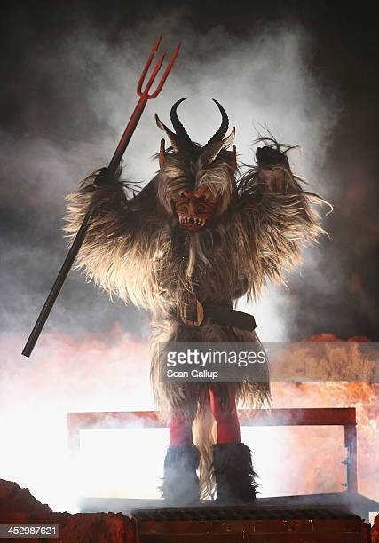 A junior member of the Haiminger Krampusgruppe dressed as the Krampus creature emerges from Hell after having been transformed from a delinquent...