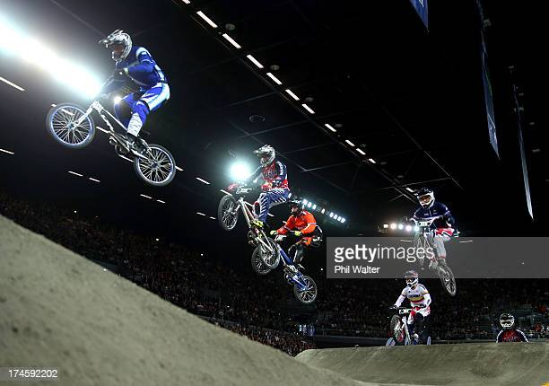 Junior Men riders clear a jump during day five of the UCI BMX World Championships at Vector Arena on July 28 2013 in Auckland New Zealand