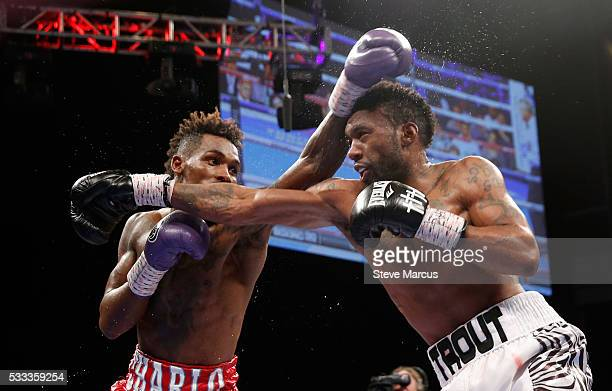 IBF junior middleweight champion Jermall Charlo and Austin Trout battle during their title fight at The Chelsea at The Cosmopolitan of Las Vegas on...