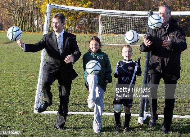 Junior Ministers Jeffrey Donaldson and Gerry Kelly with Emma McNally and Ryan Spence from Clifftonville primary school in Belfast during an...