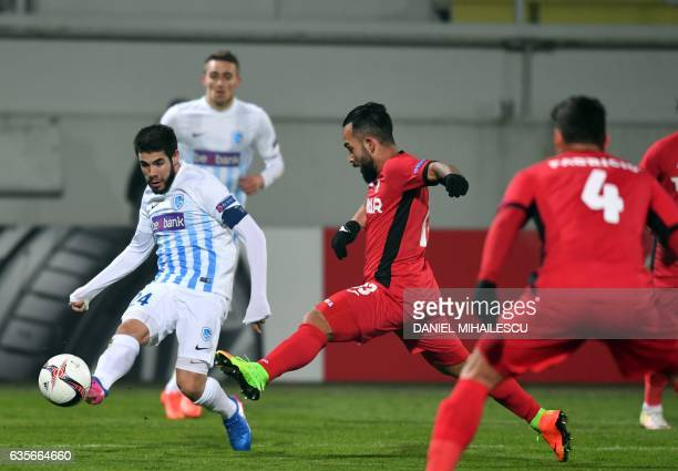 Junior Morais of Astra Giurgiu vies for the ball with Alejandro Pozuelo of KRC Genk during the UEFA Europa League round of 32 firstleg football match...