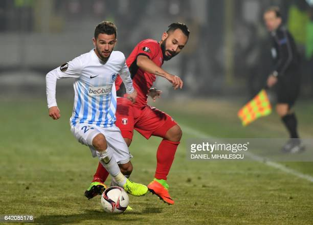Junior Morais of Astra Giurgiu vies for the ball with Siebe Schrijvers of KRC Genk during the UEFA Europa League round of 32 firstleg football match...