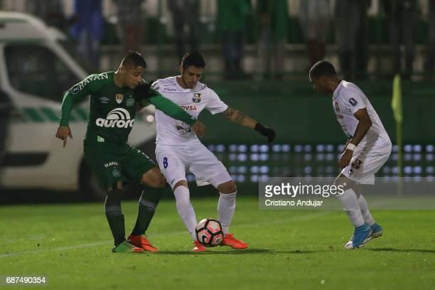 Junior Moreno of Zulia battles Joao Pedro of Chapecoense during a match between Chapecoense and Zulia as part of Copa Bridgestone Libertadores at...