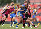 Junior Paulo of the Eels is tackled during the NRL Trial Match between the Penrith Panthers and the Parramatta Eels at Sportingbet Stadium on...