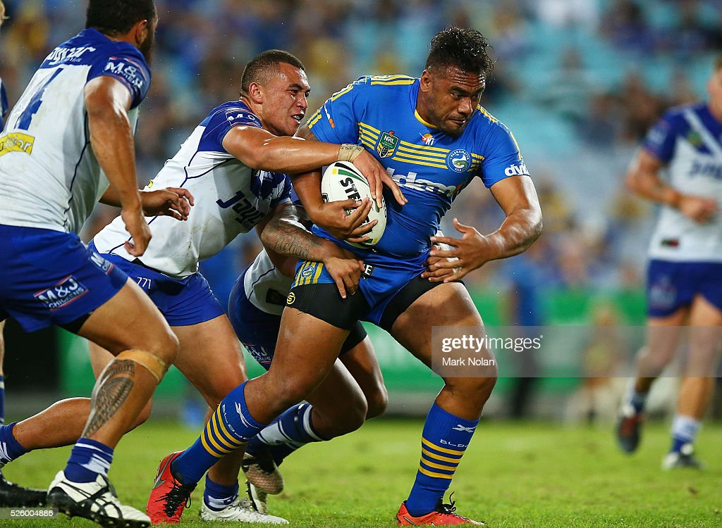 Junior Paulo of the Eels is tackled during the round nine NRL match between the Parramatta Eels and the Canterbury Bulldogs at ANZ Stadium on April 29, 2016 in Sydney, Australia.