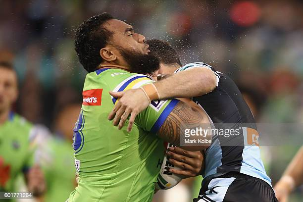 Junior Paulo of the Raiders is tackled during the NRL Qualifying Final match between the Canberra Raiders and the Cronulla Sharks at GIO Stadium on...