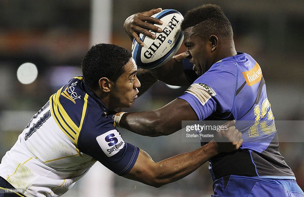 Junior Rasolea of the Force is tackled by Joe Tomane of the Brumbies during the round 11 Super Rugby match between the Brumbies and the Force at Canberra Stadium on April 27, 2013 in Canberra, Australia.