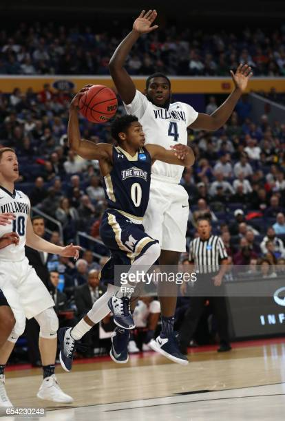 Junior Robinson of the Mount St Mary's Mountaineers goes up for a shot against Eric Paschall of the Villanova Wildcats in the first half during the...