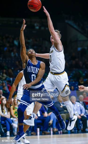 Junior Robinson of the Mount St Mary's Mountaineers shoots the ball as Rex Pflueger of the Notre Dame Fighting Irish makes the block at Purcell...