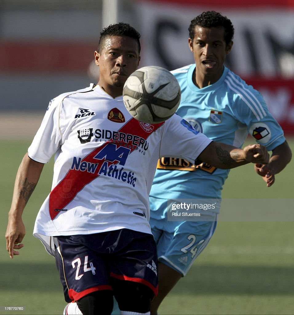 Junior Ross (R) of Sporting Cristal fights for the ball with Cesar Doy (L) of Jose Galvez during a match between Jose Galvez and Sporting Cristal as part of The Torneo Descentralizado 2013 at the Estadio Manuel Rivera Sanchez on August 18, 2013 in Chimbote, Peru.