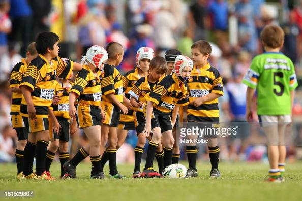 Junior rugby league players take part in a match during the half time break of the Country Rugby League South Coast Group 7 Grand Final match between...