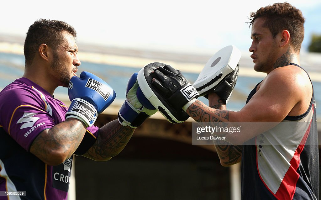 Junior Sa'u of the Storm and Kimami Sitauti of the Rebels box during a Melbourne Storm and Melbourne Rebels training session at Visy Park on January 17, 2013 in Melbourne, Australia.