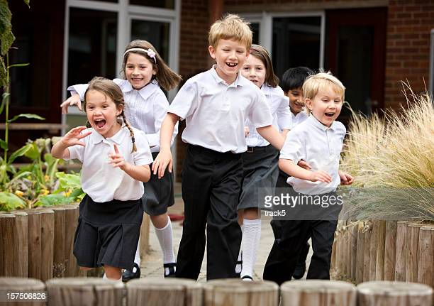 junior school: children smiling and running in school uniforms