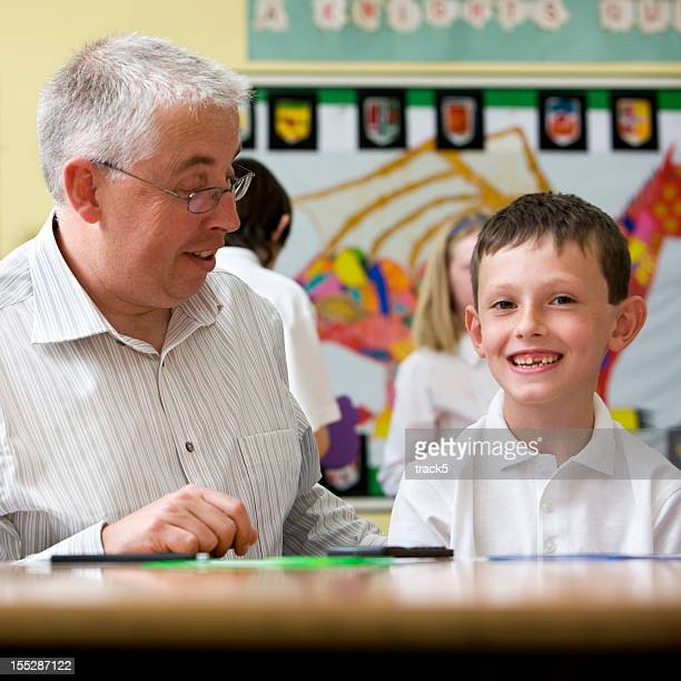 junior school: star pupil with teacher