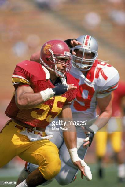 Junior Seau of the University of Southern California Trojans runs on the field during the NCAA game against the Ohio State University Buckeyes at Los...