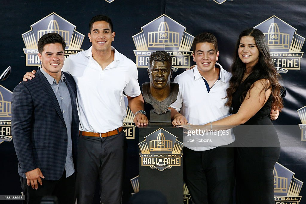 Junior Seau's children pose with his bust during the NFL Hall of Fame induction ceremony at Tom Benson Hall of Fame Stadium on August 8 2015 in...