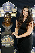 Junior Seau's daughter Sydney Seau poses with her father's bust during the NFL Hall of Fame induction ceremony at Tom Benson Hall of Fame Stadium on...