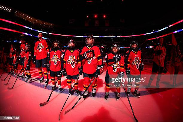 Junior skaters line up on the ice for the national anthem with the Florida Panthers and the Washington Capitals prior to the start of the game at the...