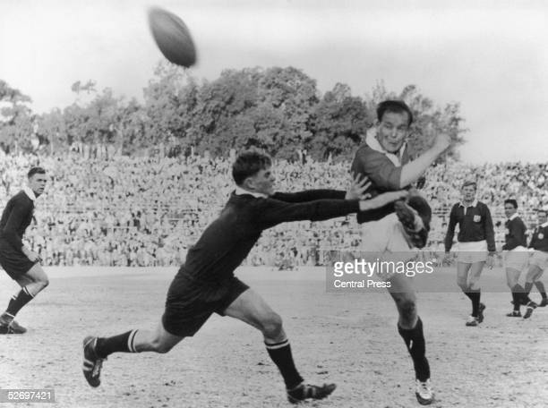Junior Springboks player Brian Harrison tries to prevent Dickie Jeeps kicking the ball during a game against the British Lions at Pretoria 9th July...