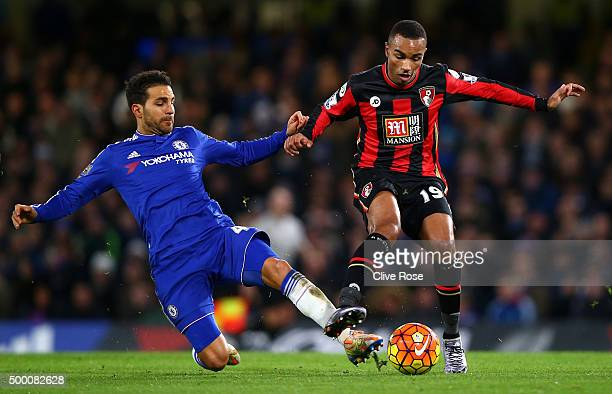 Junior Stanislas of Bournemouth and Cesc Fabregas of Chelsea compete for the ball during the Barclays Premier League match between Chelsea and AFC...
