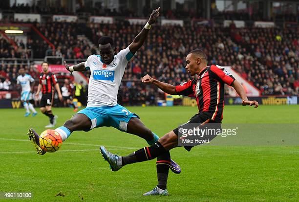 Junior Stanislas of Bournemouth and Cheik Ismael Tiote of Newcastle United compete for the ball during the Barclays Premier League match between AFC...