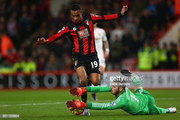 Junior Stanislas of Bournemouth and David De Gea of Manchester United compete for the ball during the Barclays Premier League match between AFC...