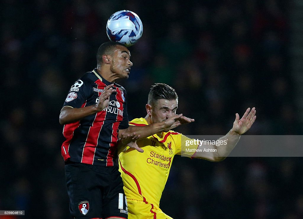 Junior Stanislas of Bournemouth and Jordan Henderson of Liverpool