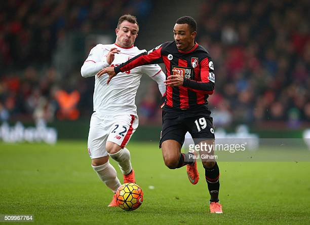 Junior Stanislas of Bournemouth and Xherdan Shaqiri of Stoke City compete for the ball during the Barclays Premier League match between AFC...