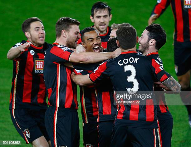 Junior Stanislas of Bournemouth celebrates scoring their first goal with his team mates during the Barclays Premier League match between AFC...