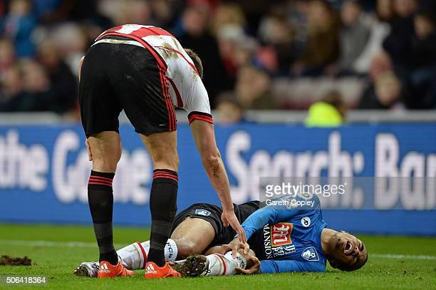 Junior Stanislas of Bournemouth lies on the ground injured during the Barclays Premier League match between Sunderland and AFC Bournemouth at the...