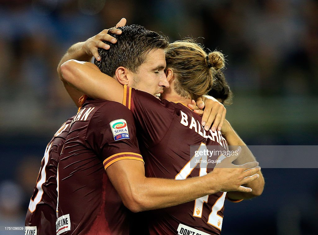 Junior Tallo #20, <a gi-track='captionPersonalityLinkClicked' href=/galleries/search?phrase=Kevin+Strootman&family=editorial&specificpeople=5566501 ng-click='$event.stopPropagation()'>Kevin Strootman</a> #6 and <a gi-track='captionPersonalityLinkClicked' href=/galleries/search?phrase=Federico+Balzaretti&family=editorial&specificpeople=686070 ng-click='$event.stopPropagation()'>Federico Balzaretti</a> #42 of AS Roma congratulate each other after scoring during the 2013 Major League Soccer All Star Game against the MLS All-Stars at Sporting Park on July 31, 2013 in Kansas City, Kansas.