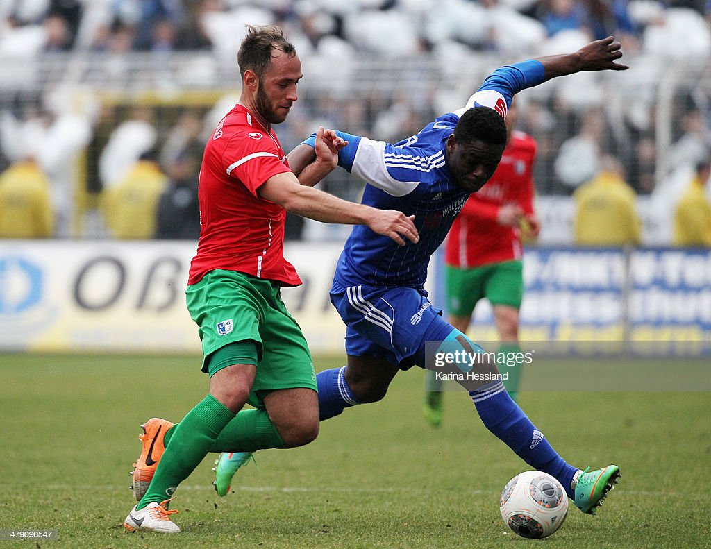 Junior Torunarigha of Jena and Christopher Handke of Magdeburg battle for the ball during the Regionalliga match between FC Carl Zeiss Jena and 1.FC Magdeburg at Ernst Abbe Sportfeld on March 16, 2014 in Jena, Germany.