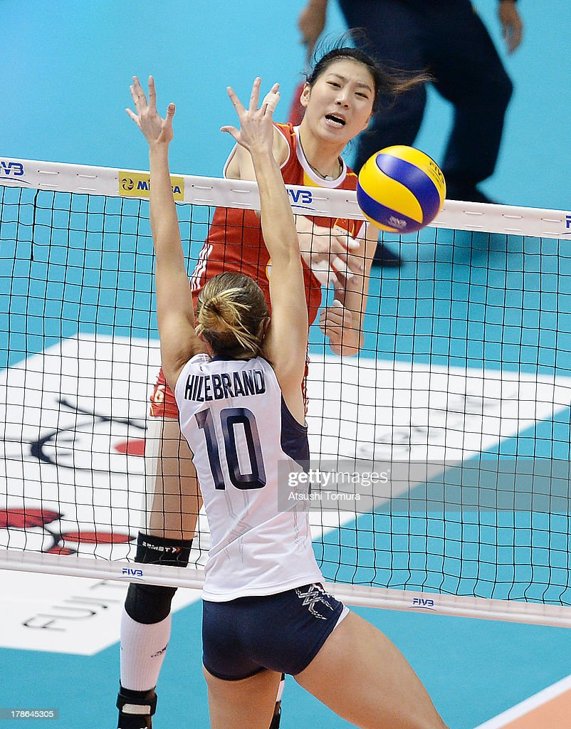 Junjing Yang of China spikes the ball during day three of the FIVB World Grand Prix Sapporo 2013 match between China and USA at Hokkaido Prefectural Sports Center on August 30, 2013 in Sapporo, Hokkaido, Japan.