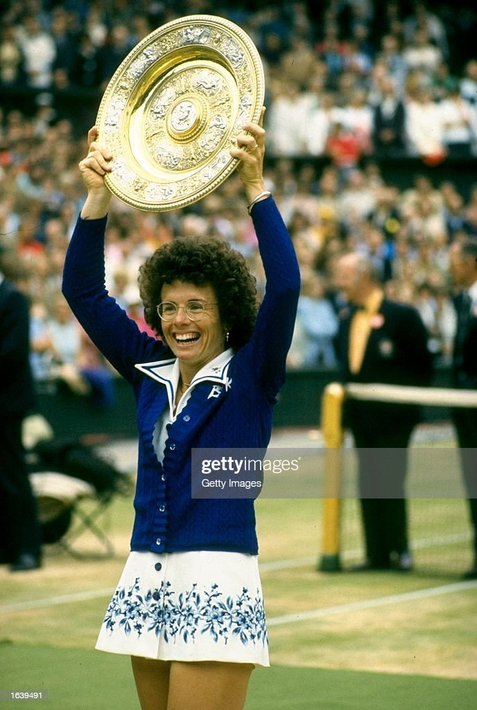 <a gi-track='captionPersonalityLinkClicked' href=/galleries/search?phrase=Billie+Jean+King&family=editorial&specificpeople=93147 ng-click='$event.stopPropagation()'>Billie Jean King</a> of the USA holds the trophy aloft after the Lawn Tennis Championships at Wimbledon in London. King won the Women's Singles event. \ Mandatory Credit: Allsport UK /Allsport