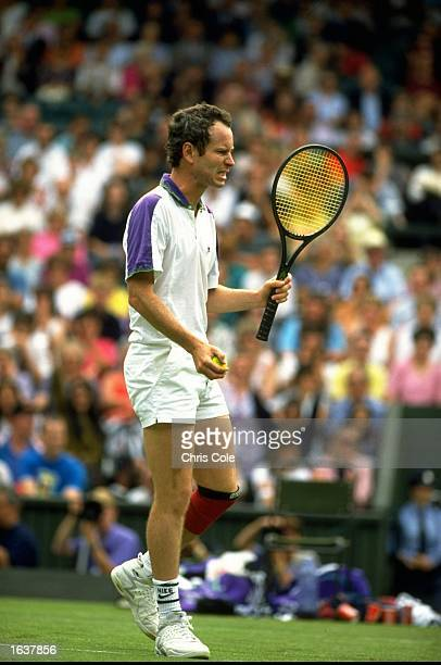 John McEnroe of the USA grits his teeth during the Lawn Tennis Championships at Wimbledon in London Mandatory Credit Chris Cole/Allsport