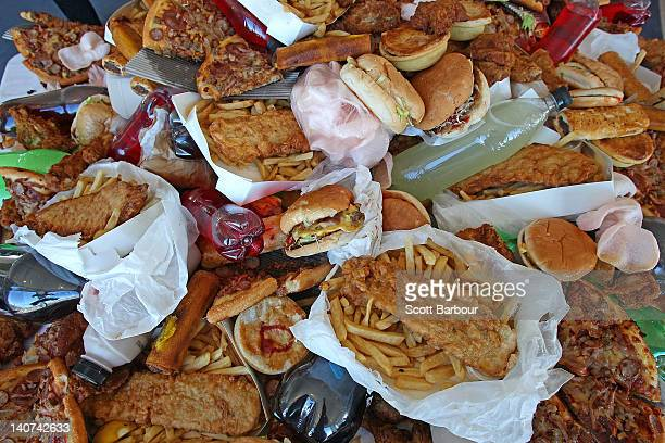 Junk food sits on a table as British Celebrity Chef Jamie Oliver announces a partnership to attack statewide obesity on March 6 2012 in Melbourne...