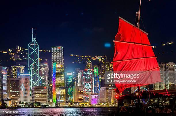 A junk ship docking near Hong Kong at night
