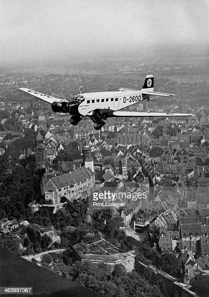 Junkers Ju 52 aircraft D2600 over Nuremberg Germany 1934 The plane carrying Nazi leader Adolf Hitler to the Nuremberg Rally A print from Adolf Hitler...