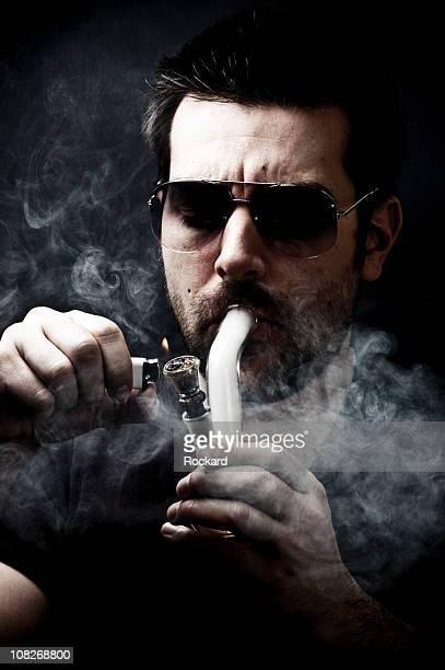 junkie smoking bong,