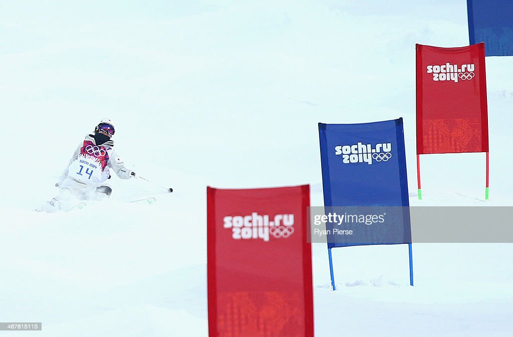Junko Hoshino of Japan runs off the course as she competes during Ladies' Moguls Qualification during day 1 of the Sochi 2014 Winter Olympics at Rosa...