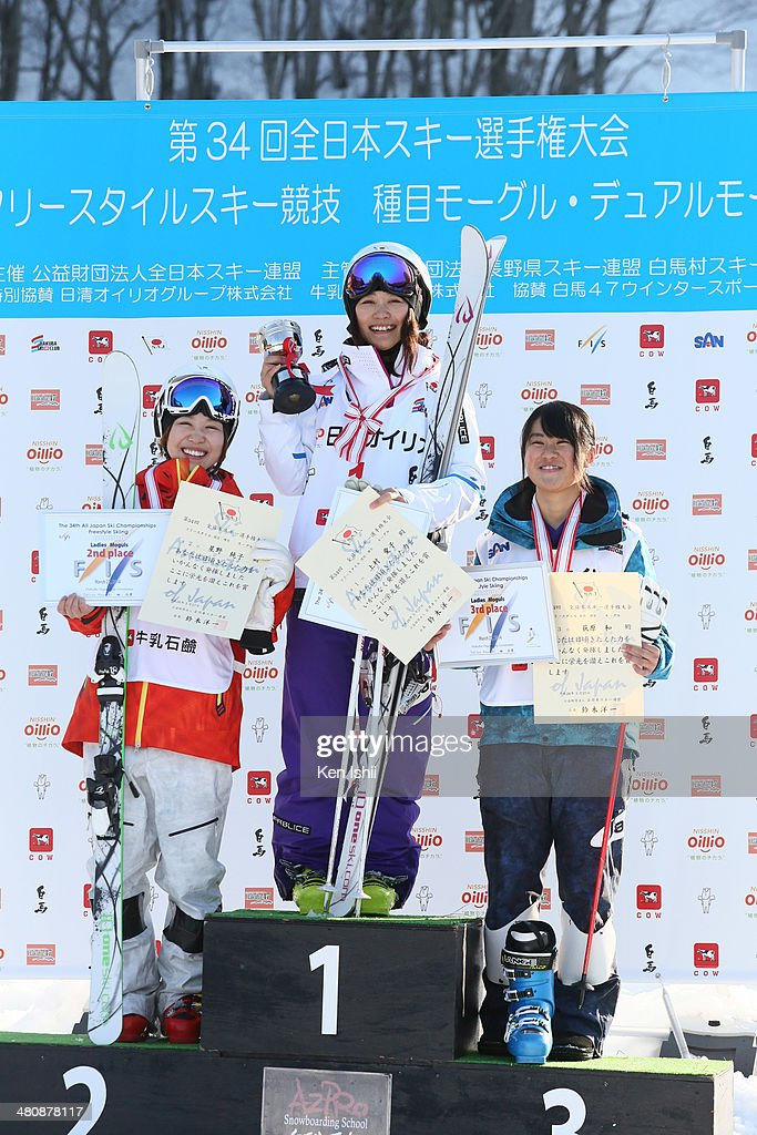 Junko Hoshino of Japan second place Aiko Uemura of Japan first place Nagi Ogiwara of Japan third place pose for photo at podium after competition of...