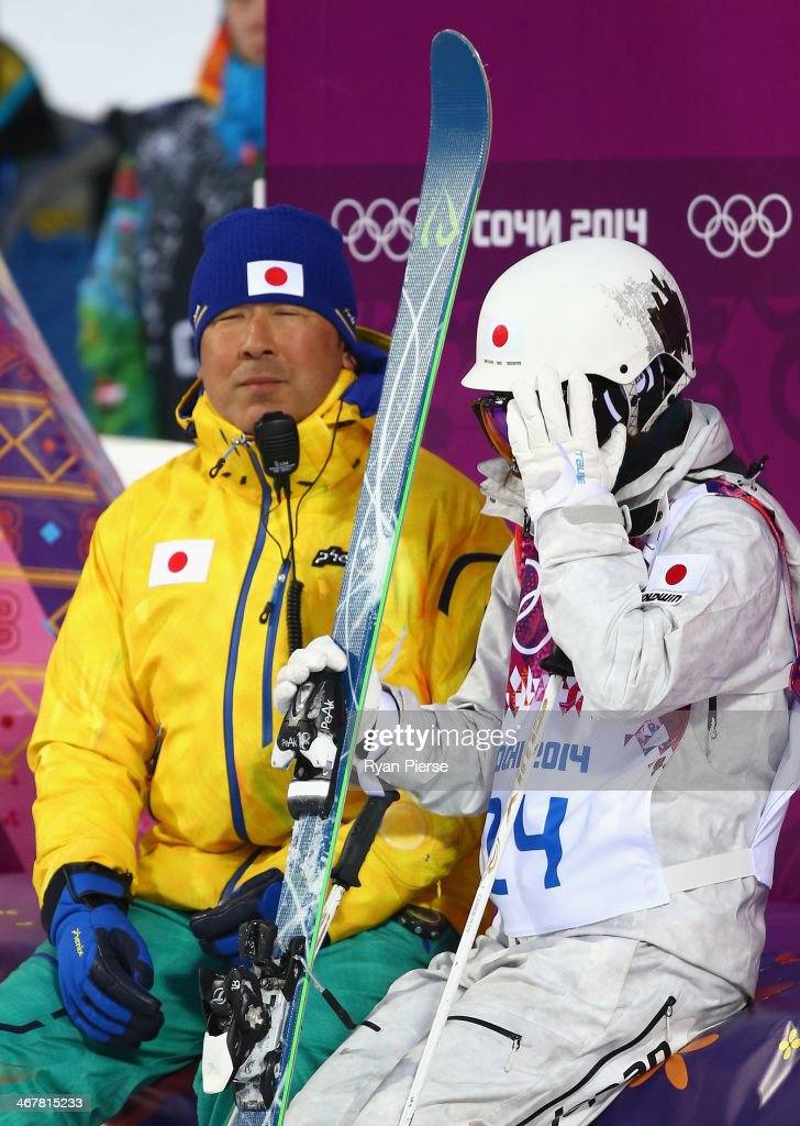 Junko Hoshino of Japan waits for her score during Ladies' Moguls Qualification during day 1 of the Sochi 2014 Winter Olympics at Rosa Khutor Extreme...
