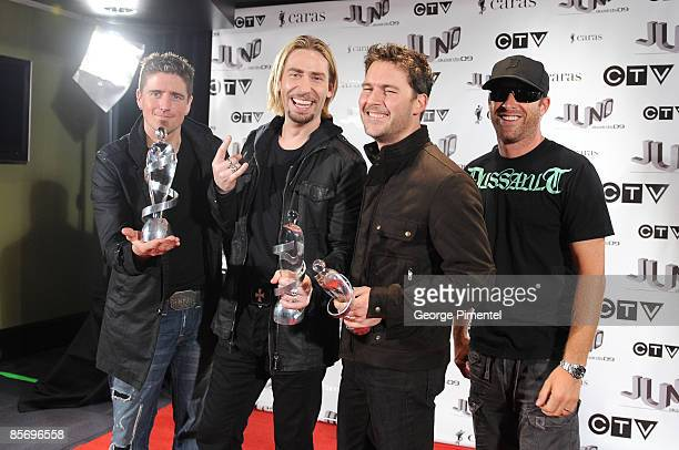 Juno Award Winners for Juno Fan Choice Album of the Year 'Dark Horse' and Group of the Year Daniel Adair Chad Kroeger Ryan Peake and Mike Kroeger of...