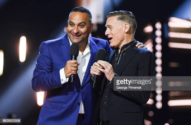 Juno Awards hosts Russell Peters and Bryan Adams at Canadian Tire Centre on April 2 2017 in Ottawa Canada