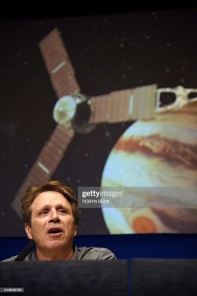 Juno Mission Principal Investigator Scott Bolton speaks at a press conference at the Jet Propulsion Laboratory (JPL) in Pasadena, California, June 30, 2016 to announce 'Destination: Juno,' a collaboration between NASA and Apple to bring 'exploratory' music inspired by space from artists such as Brad Paisley, Corinne Bailey Rae, GZA, Jim James featuring Lydia Tyrell, Trent Reznor & Atticus Ross, Weezer and Zoé to Apple Music and iTunes listeners. The Juno spacecraft is scheduled to enter Jupiter's orbit on July 4, 2016 after a five years voyage to the fifth planet from the sun. / AFP / Robyn Beck
