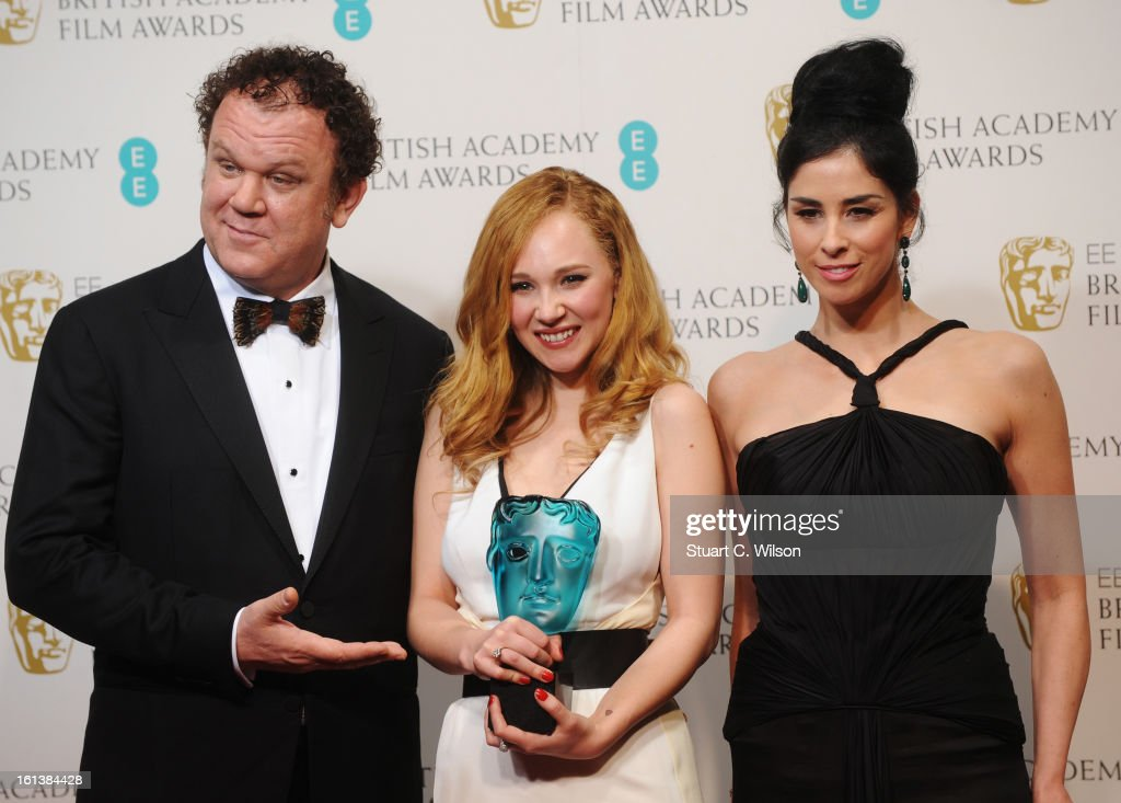 Juno Temple, winner of EE Rising Star, poses in the press room with presenters John C. Reilly (L) and Sarah Silverman (R) at the EE British Academy Film Awards at The Royal Opera House on February 10, 2013 in London, England.
